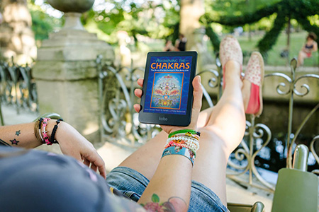 Photo of girl reading Awakening The Chakras on an ereader